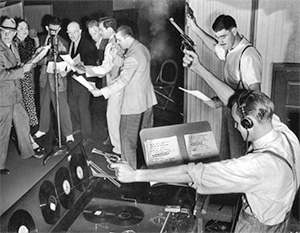 Sound effects guys at work doing a live old time radio broadcast