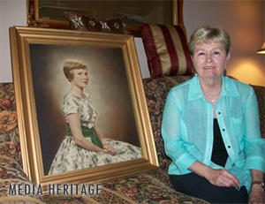 Linda Hern, Ruth Lyons' niece, with a portrait of Candy Newman, Ruth Lyons' daughter